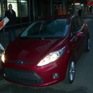It's a cute little Ford Fiesta! In Magenta!